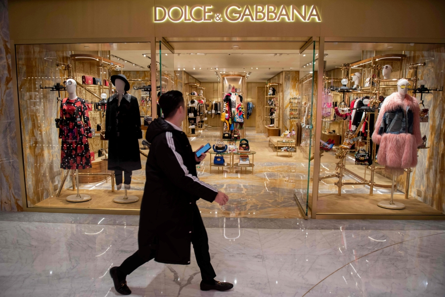 b1ab2a791a A man walks past a Dolce & Gabbana shop in Beijing on November 22, 2018. -  Dolce & Gabbana cancelled a long-planned fashion show in Shanghai on Nov 21  after ...