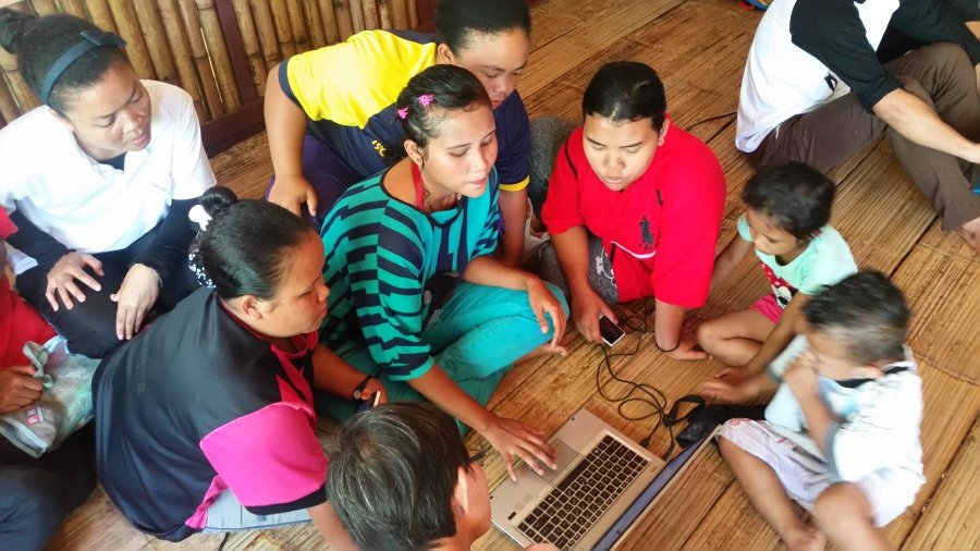 The Orang Asli community in Gerik with a refurbished laptop from SOLS Tech.