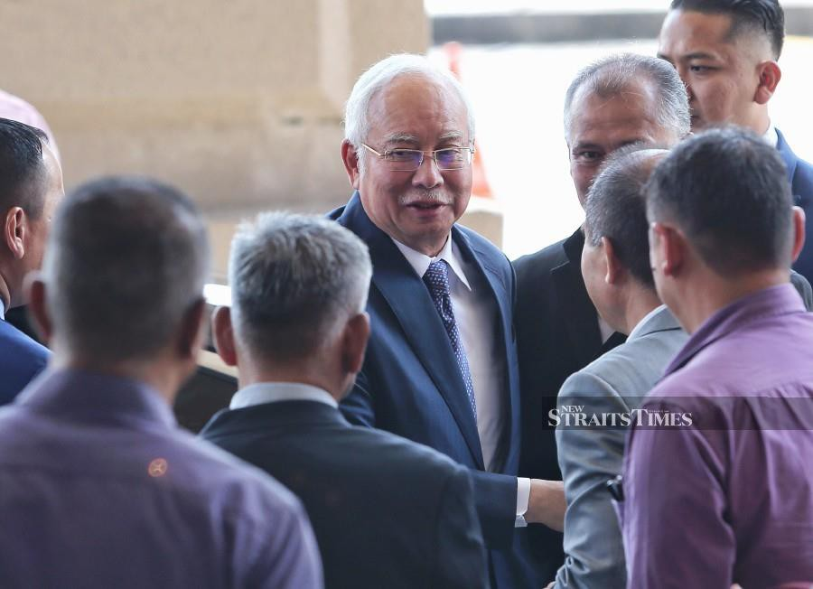 Former prime minister Datuk Seri Najib Razak meeting his supporters before continuing with the afternoon session of the money laundering and criminal breach of trust case involving RM42 million of SRC International funds. -- Pix: NSTP/ASWADI ALIAS.