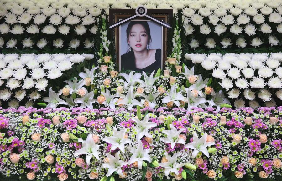 The portrait of late K-pop star Goo Hara is seen surrounded by flowers at a memorial altar at a hospital in Seoul. -AFP