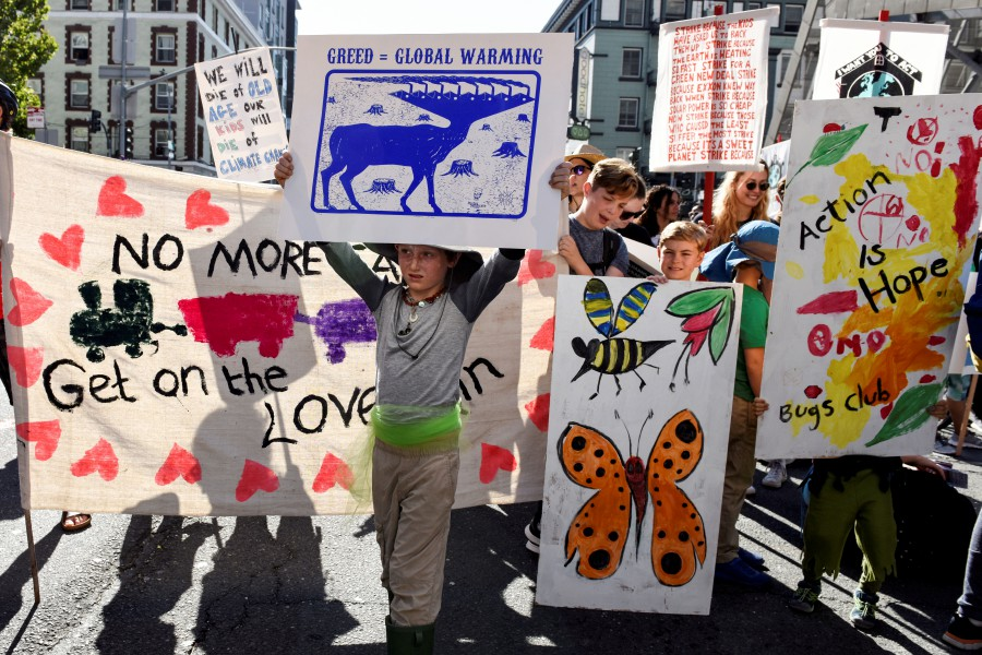 Young people protest outside of the San Francisco Federal Building during a Climate Strike march in San Francisco. - Reuters