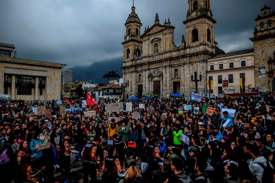 """Musicians perform during a protest at Bolivar square in Bogota, Colombia, on September 20, 2019, in the framework of the """"Friday for the planet"""" global demo against climate change.- AFP"""