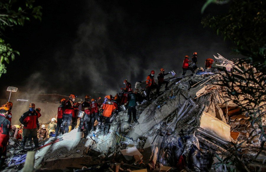 Rescue workers and people search for survivors at a collapsed building at Bayrakli district in Izmir. EPA pic