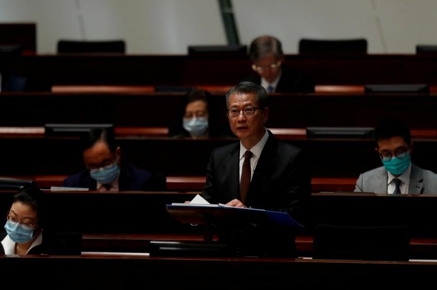 Hong Kong Financial Secretary Paul Chan delivers the annual budget at the Legislative Council in Hong Kong, China. -Reuters