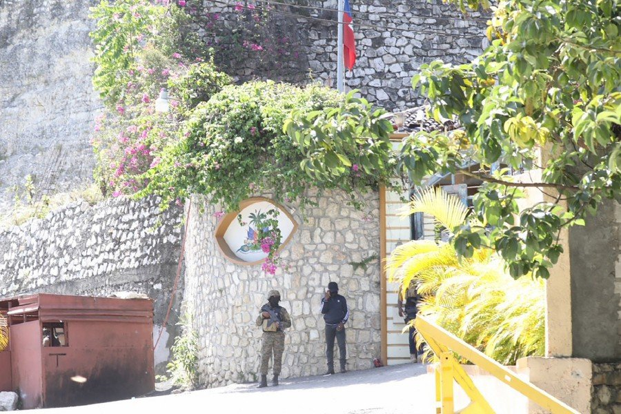 Members of the Haitian police and forensics patrol the area as they look for evidence outside of the presidential residence on July 7, 2021 in Port-au-Prince, Haiti. -AFP Pic