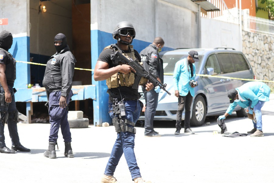 Members of the Haitian police and forensics look for evidence outside of the presidential residence on July 7, 2021 in Port-au-Prince, Haiti. - AFP Pic
