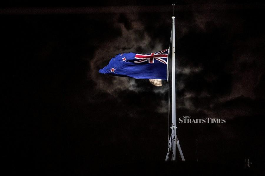 The New Zealand national flag is flown at half-mast on a Parliament building in Wellington after a shooting incident in Christchurch. - AFP