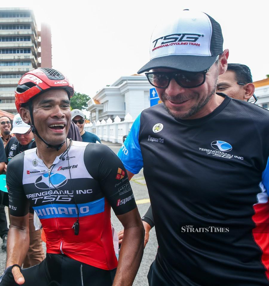 Terengganu Cycling Team (TSG) Harrif Saleh celebrates with his coach Jeremy Hunt (right) after winning the Stage Seven of the PETRONAS Le Tour de Langkawi (LTdL) in Alor Star. - NSTP/Luqman Hakim Zubir