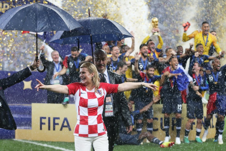 Soaked But Smiling Croatian President Wins Admirers At World Cup