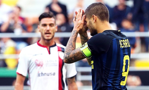 Inter's forward Mauro Icardi (right) reacts during the match against Cagliari at Giuseppe Meazza stadium in Milan. Icardi missed a penalty in a 2-1 defeat. EPA