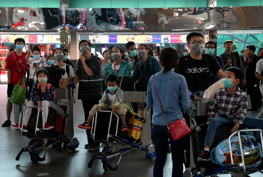 Tourists seen wearing facemask at the Kuala Lumpur International Airport on Jan 27. - Bernama