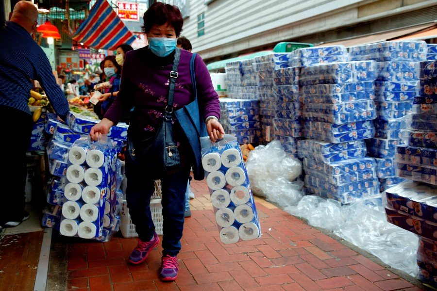 File picture of a customer picking up rolls of toilet paper at a Hong Kong market following the coronavirus outbreak February 8. -REUTERS pic