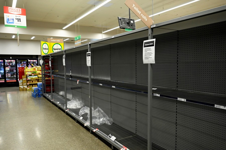 Empty shelves left after customers stocked up on toilet paper amid coronavirus fears are seen in a grocery store in Sydney, Australia. -REUTERS pic