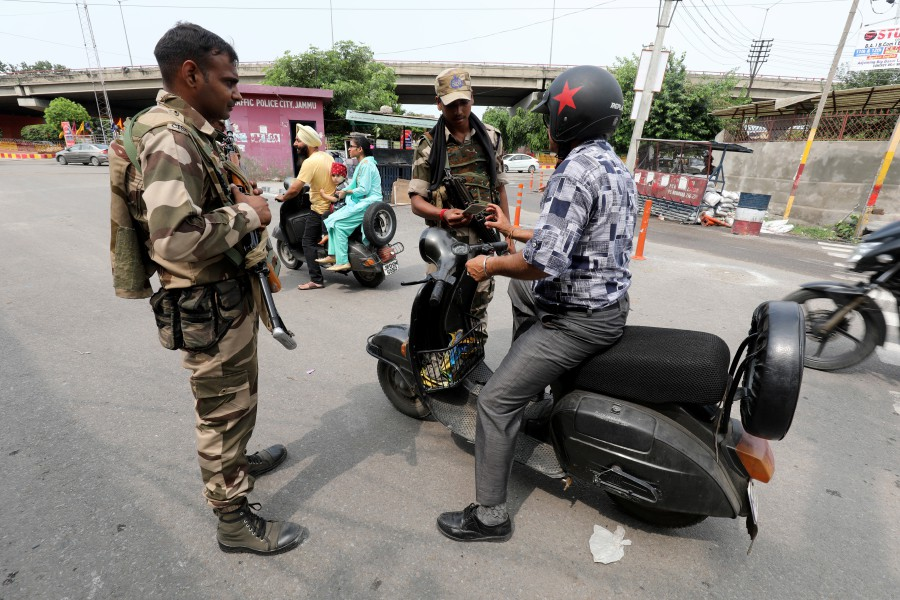 Indian paramilitary soldiers stop the commuters during curfew in Jammu, the winter capital of Kashmir, India, 05 August 2019. Indian Home Minister Amit Shah moved a resolution in the parliament that all clauses of Article 370, which accords special status to Jammu & Kashmir will not be applicable to Jammu and Kashmir. — EPA