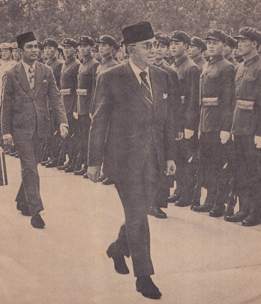 Tun Abdul Razak inspecting a guard of honour formed by the Chinese Army, Navy and Air Force upon his arrival at the Beijing Airport.