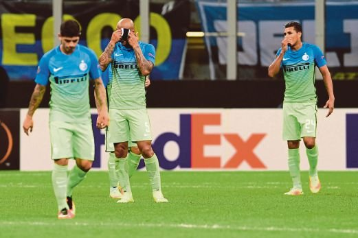 Inter Milan's players react after Hapoel Beer Sheva scored a goal. AFP