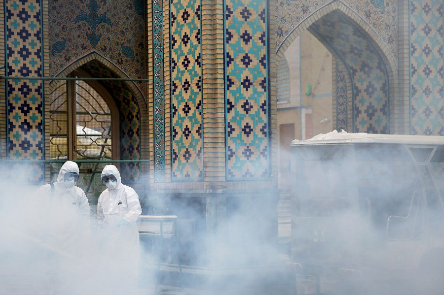 Members of the medical team spray disinfectant to sanitize outdoor place of Imam Reza's holy shrine, following the coronavirus outbreak, in Mashhad, Iran. REUTERS/FILE PIC