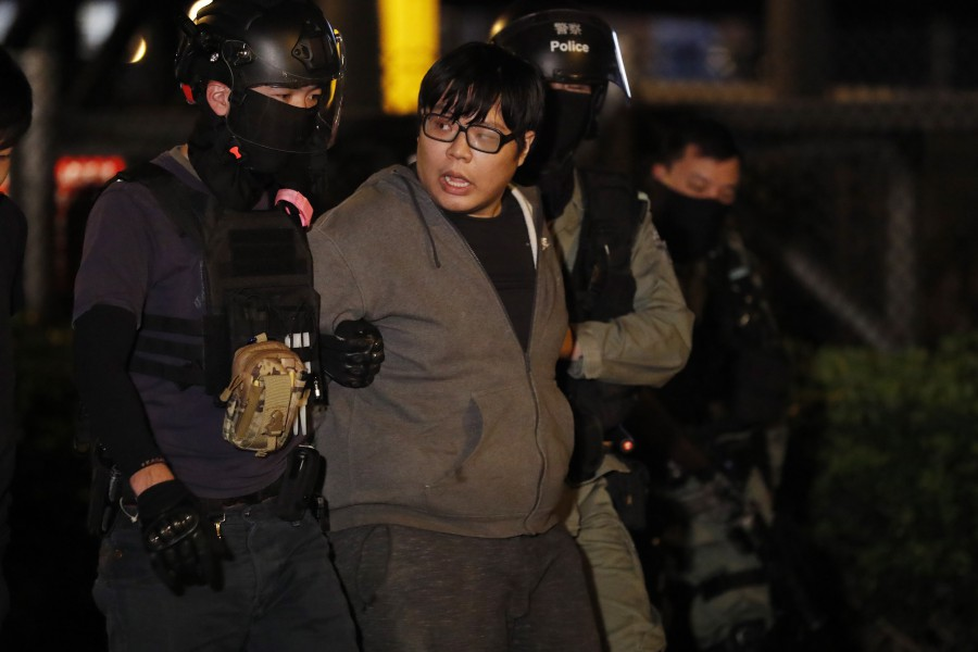 Police arrest a protester after he tried to escape from Hong Kong Polytechnic University (PolyU) in Hong Kong. - EPA