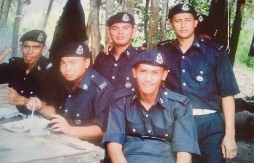Marine Police Corporal Abd Rajah Jamuan, 32 (standing far right)Pix by Abdul Rahemang Taiming