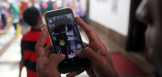two pedestrians in sg petani hit by car while playing pokemon go