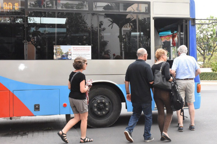 A handout photo from Fresh News shows passengers, who disembark from the Westerdam cruise ship in Sihanoukville, boarding a bus for a visit of the capital Phnom Penh. -AFP/Fresh News