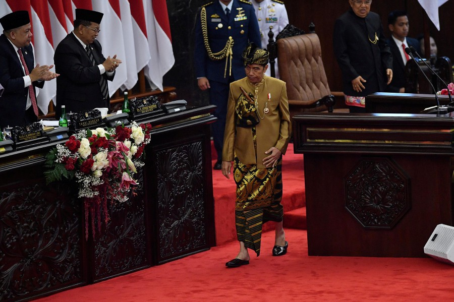 Indonesia President Joko Widodo walks after delivering a speech in front of the parliament members ahead of Independence Day, at the parliament building in Jakarta, Indonesia. - Antara Foto/Sigid Kurniawan/ via Reuters