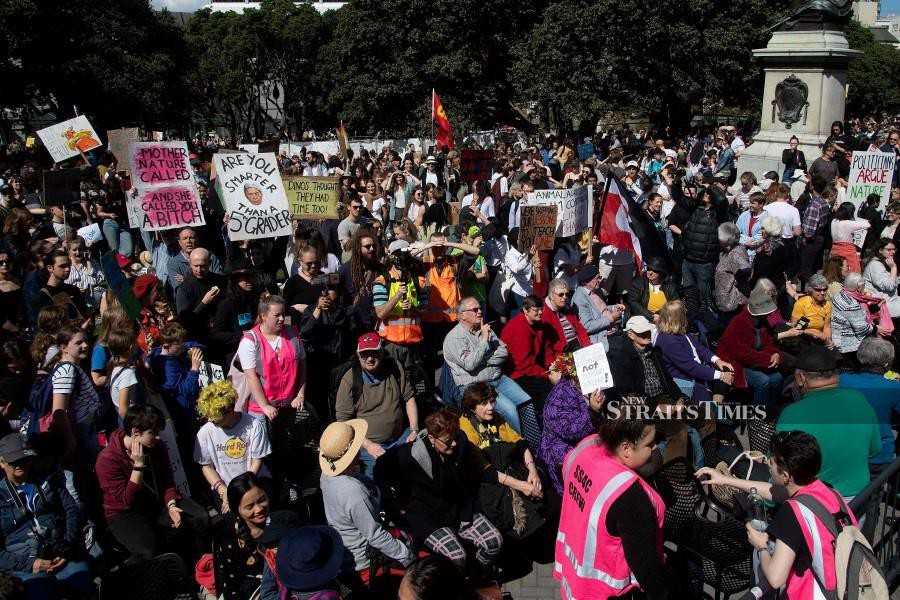 More than 40,000 people packed into the grounds of Wellington's parliament buildings on September 27, giving the latest global climate strike a flying start with the largest turnout yet seen in New Zealand. -AFP