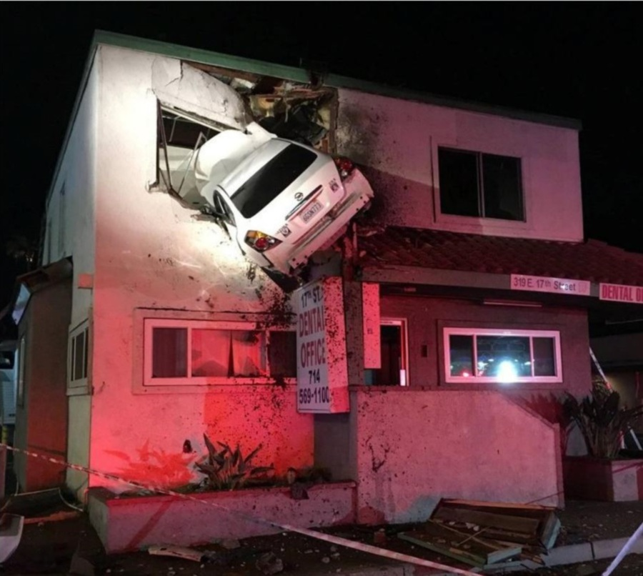 Image result for Car goes airborne, crashes into 2nd-floor dental office in Santa Ana