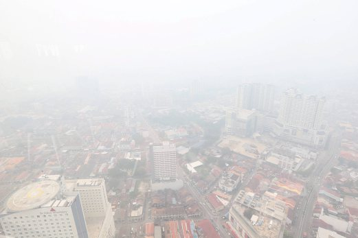 An aerial view of George Town covered in thick smoke. Pix by MUHAMMAD MIKAIL ONG