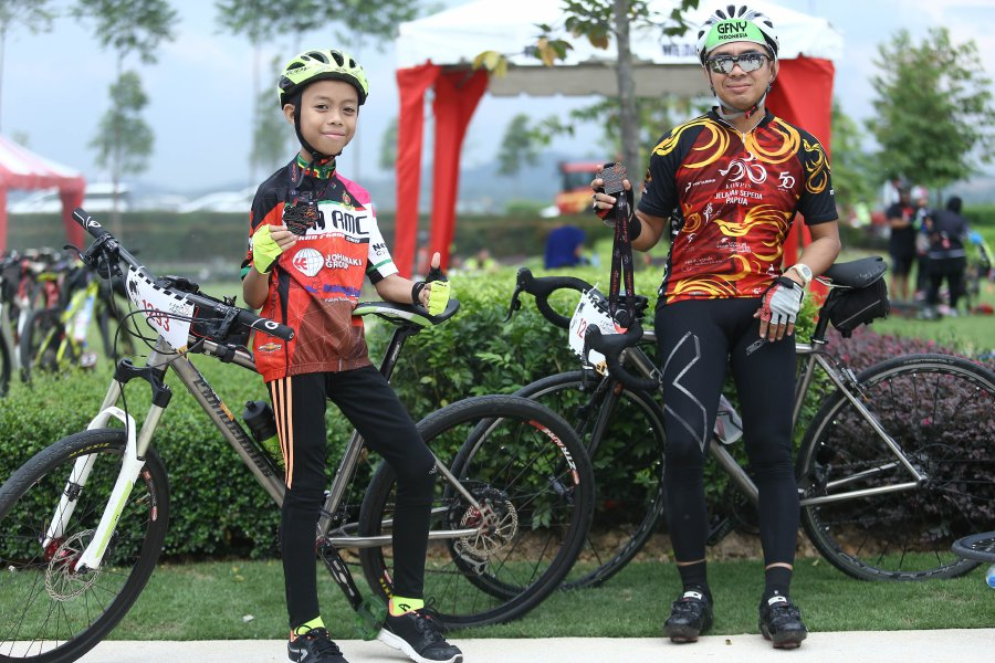 Disabled 9-year-old swept up by joy of C-Cycle Challenge | New