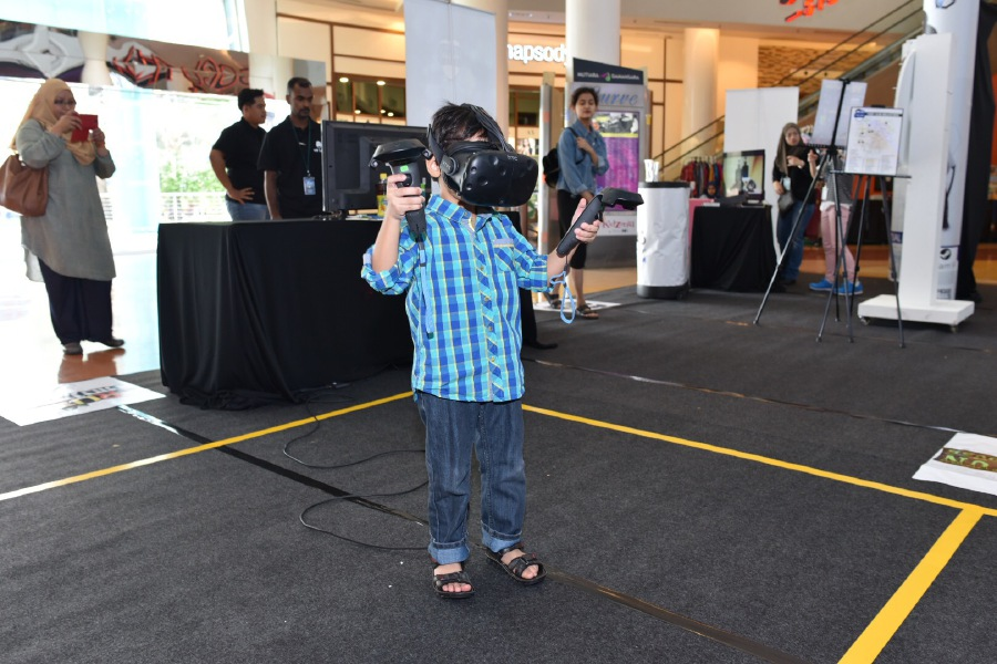 A child tries out the one of the VR games.