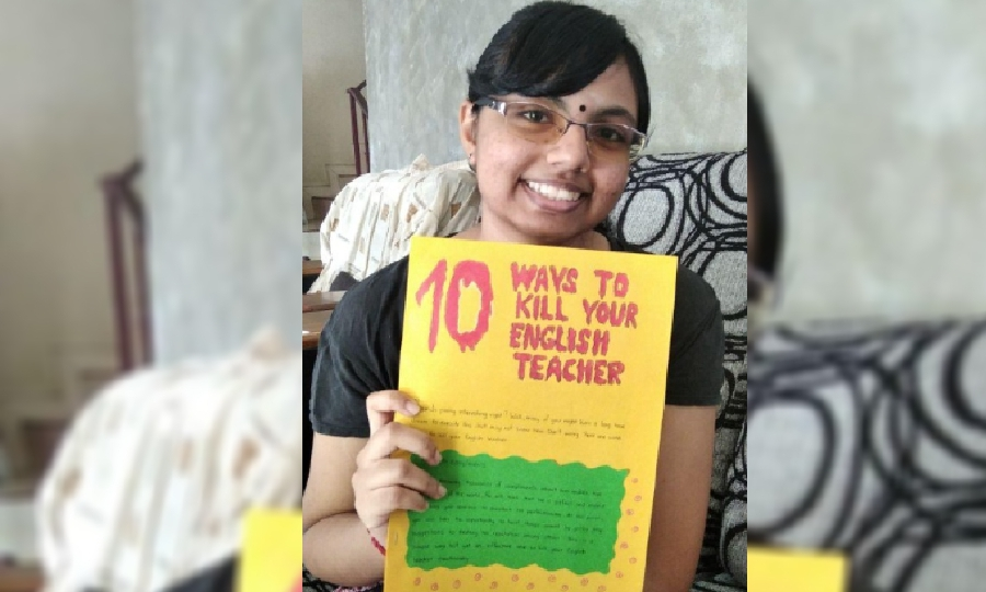 A student holding up one of the English language projects by English teacher Mohana Ram Murugiah.