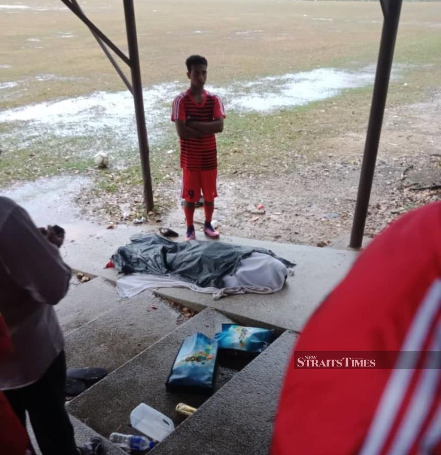 A Myanmar national died after he was struck by lightning at the Setia Alam Badminton Academy field here today. (Pic courtesy from NSTP reader)
