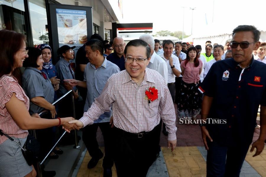 Lim Guan Eng greeting people during the opening of McDonald's Drive-Thru in Bagan Ajam. NSTP/MIKAIL ONG