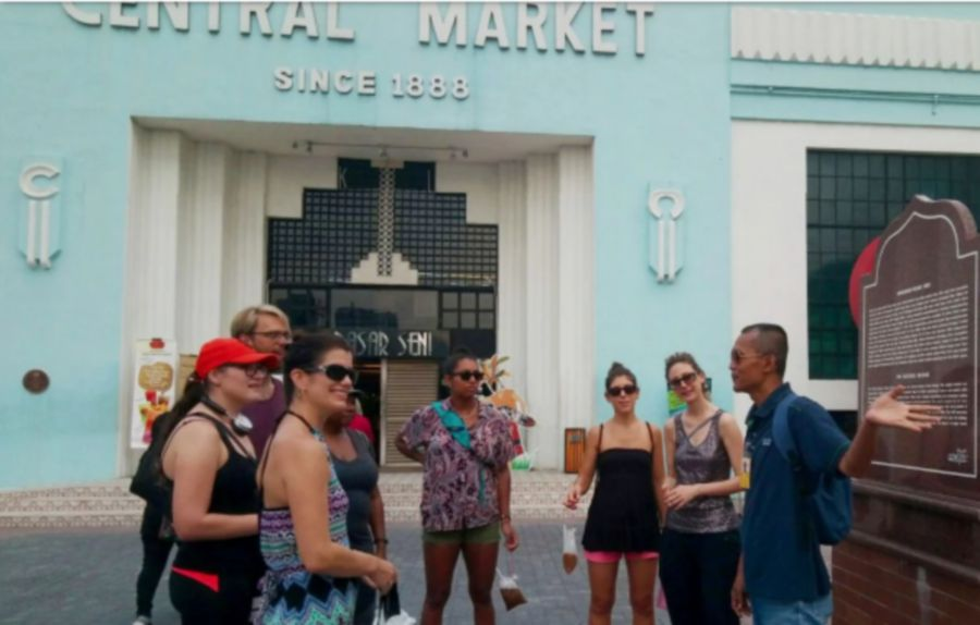 A tour guide from Yellow House KL and tourists outside the Central Market. Photo: courtesy of Yellow House KL