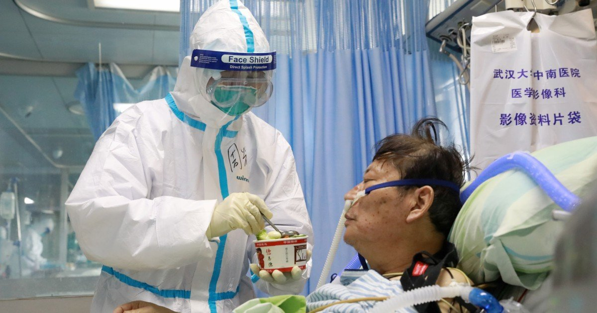 China Covid-19 infections surge past 70,000; death toll at 1,765