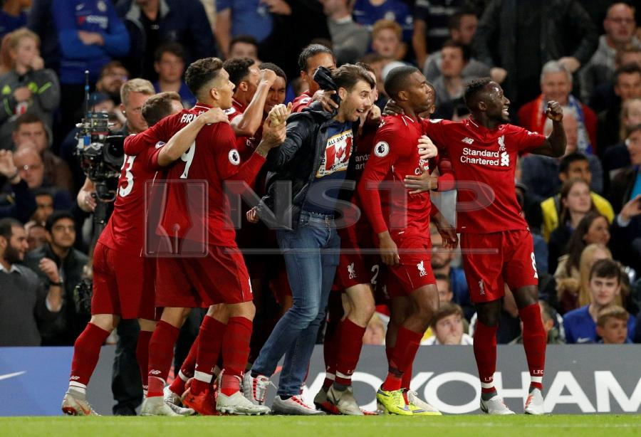 d3f499a790e Super sub Sturridge salvages Liverpool s unbeaten run at Chelsea ...