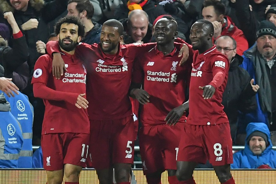 Liverpool's Senegalese striker Sadio Mane (2nd R) celebrates with teammates after scoring the opening goal of the English Premier League football match between Liverpool and Manchester United at Anfield in Liverpool. (Photo by AFP)