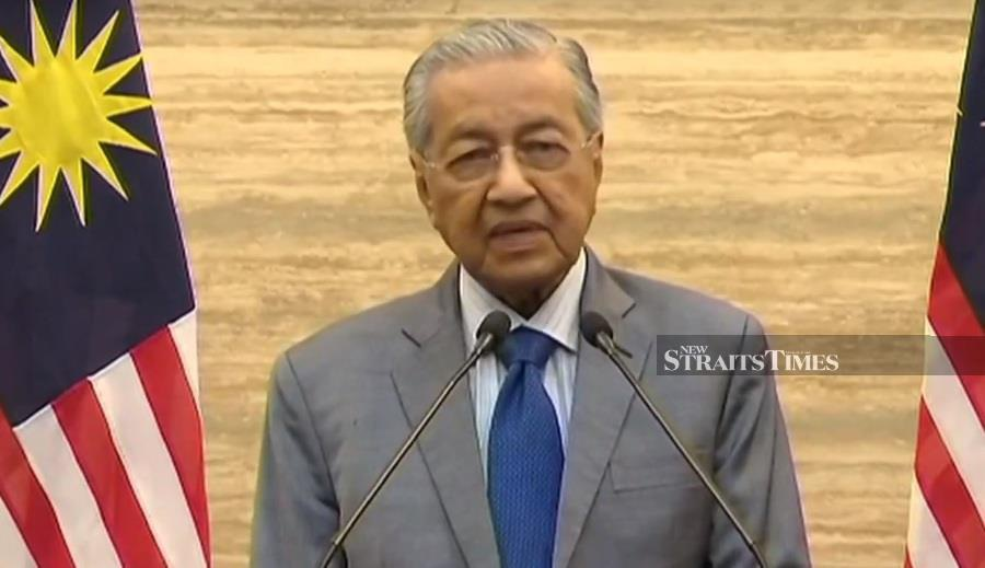 Tun Dr Mahathir Mohamad addresses the nation in a televised speech.