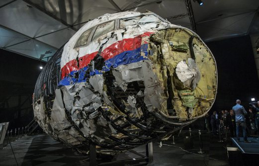 The reconstructed wreckage of the MH17 airplane is seen after the presentation of the final report into the crash of July 2014 of Malaysia Airlines flight MH17 over Ukraine, in Gilze Rijen, the Netherlands. REUTERS