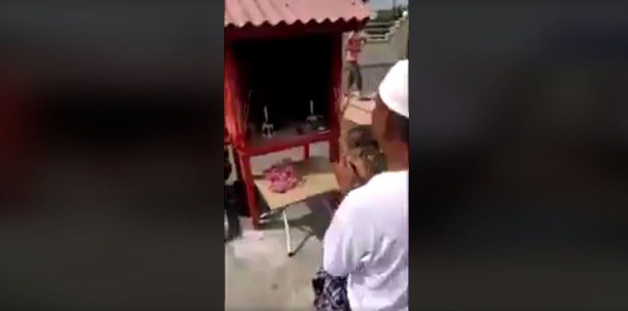 White Shirt And Sarong Holding Incense Sticks And Worshipping Before An Outdoor Dato Kong Alter Pix From Video Viral Malaysia Facebook Account