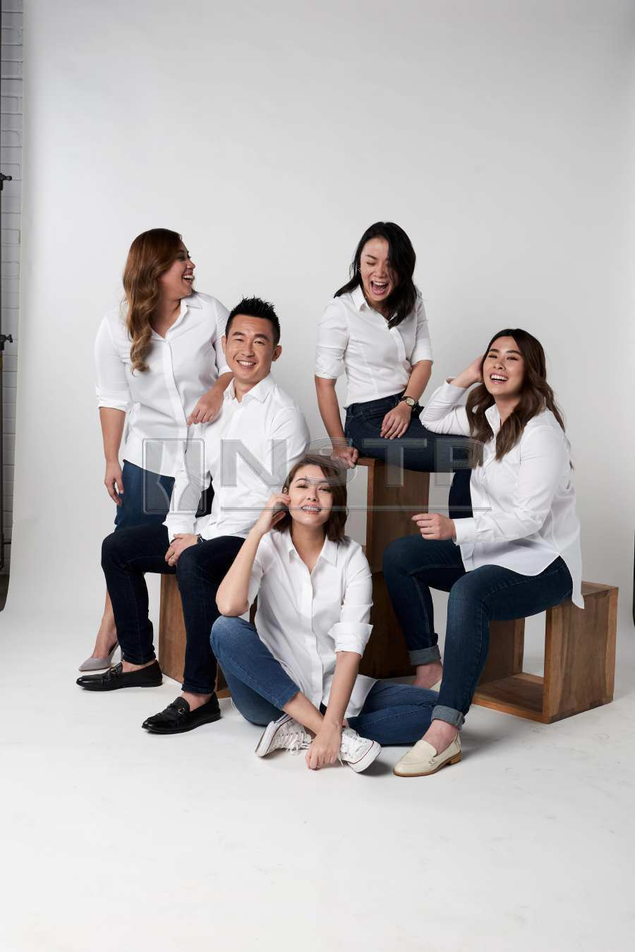 White shirts for ladies – CK Chang (seated, second from left) says the shirts are ideal for women of all shapes and sizes. (Picture credit: Oxwhite)