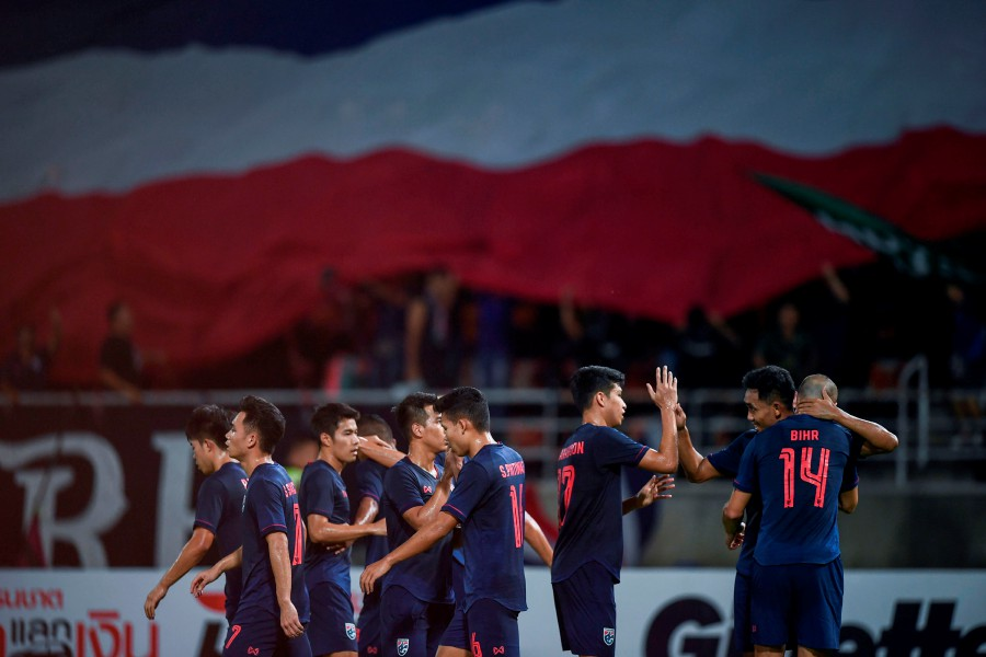 Thailand's Teerasil Dangda (right) celebrates with teammates during the match against the United Arab Emirates in Bangkok. - AFP