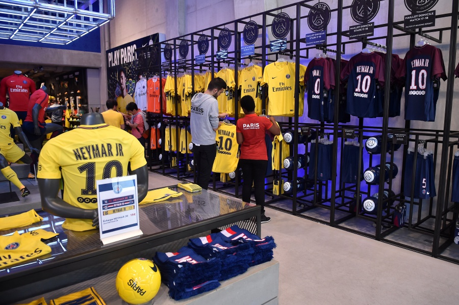 Employees of the official Paris Saint-Germain (PSG) store display the new  jerseys of Brazilian striker Neymar Jr (not pictured) on sale in Paris a935495ef