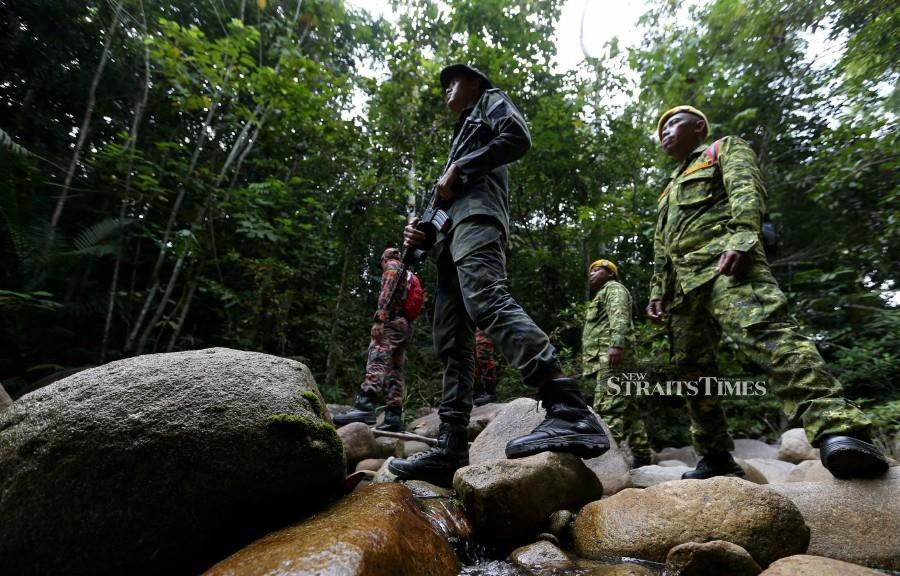 Members of the General Operations Force search the area for the missing teen in Seremban. -NSTP/Iqmal Haqim Rosman.