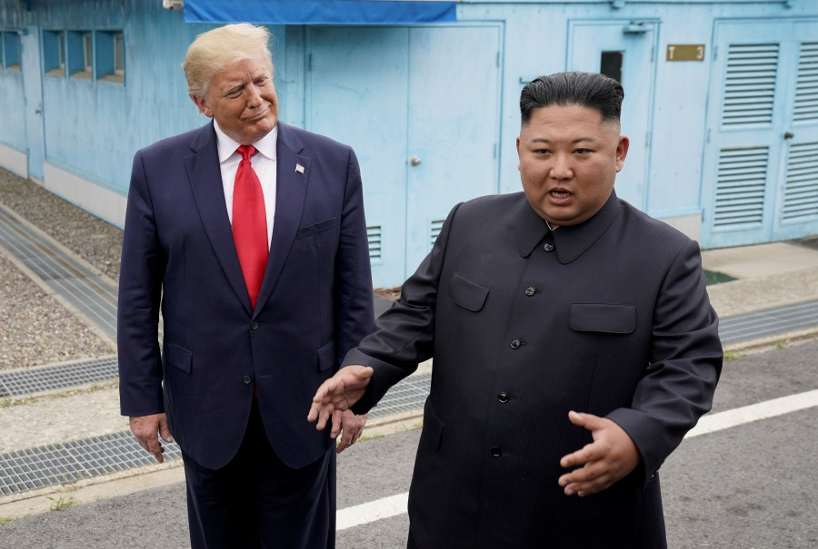 US President Donald Trump meets with North Korean leader Kim Jong Un at the demilitarized zone separating the two Koreas, in Panmunjom, South Korea, on June 30, 2019. -Reuters