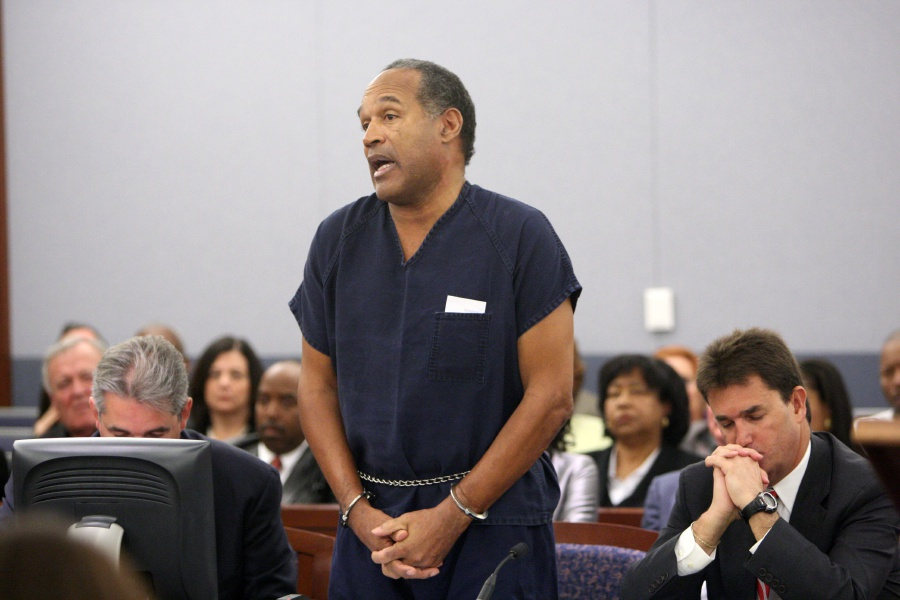(File pix) This file photo taken on December 4, 2008 shows OJ Simpson speaking in court prior to his sentencing as his attorneys Gabriel Grasso (left) and Yale Galanter listen at the Clark County Regional Justice Center in Las Vegas, Nevada. Nine years after being sent to prison for armed robbery, fallen American idol O.J. Simpson is to find out whether he will regain his freedom. The 70-year-old former football star and actor is to appear before a parole board in the western state of Nevada on July 20 which will decide his fate. Simpson, who was famously acquitted in 1995 of the grisly murders of his ex-wife and a male companion, has been behind bars for his role in a September 2007 armed robbery of two sports memorabilia dealers at a Las Vegas resort. AFP pic.