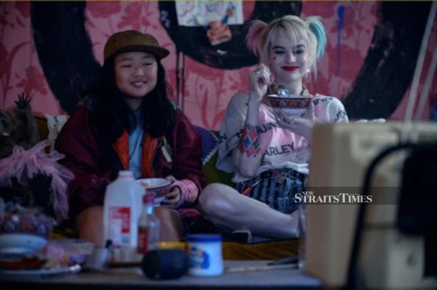 Margot Robbie (right) is a hoot as the anti-heroine Harley Quinn. (Picture courtesy of Warner Bros.)