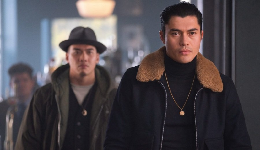Henry Golding (right) takes on a different persona for his bad boy role in the new gangster film, The Gentlemen. (Picture courtesy of TGV Pictures)