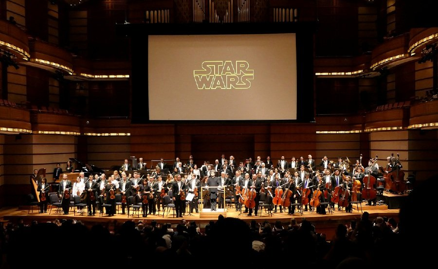 Conductor Dirk Brossé (centre) led the MPO and MPYO for a memorable concert featuring the thrilling music from the original and prequel trilogies of Star Wars (Picture courtesy of DFP-MPO)